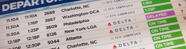 écran d'aéroport avec vols vers les USA